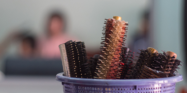 Close up of combs in basket at salon with blur background.